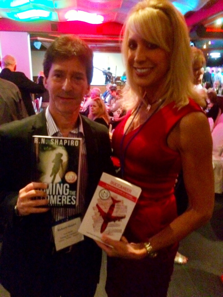 Maycay Beeler with R.N. Shapiro celebrating our book awards, 2015 Readers Favorite Miami ceremony.